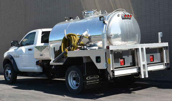 Vacuum service trucks for septic portable toilets and